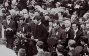 Pictured standing behind Pearse at the O'Donovan Rossa funeral